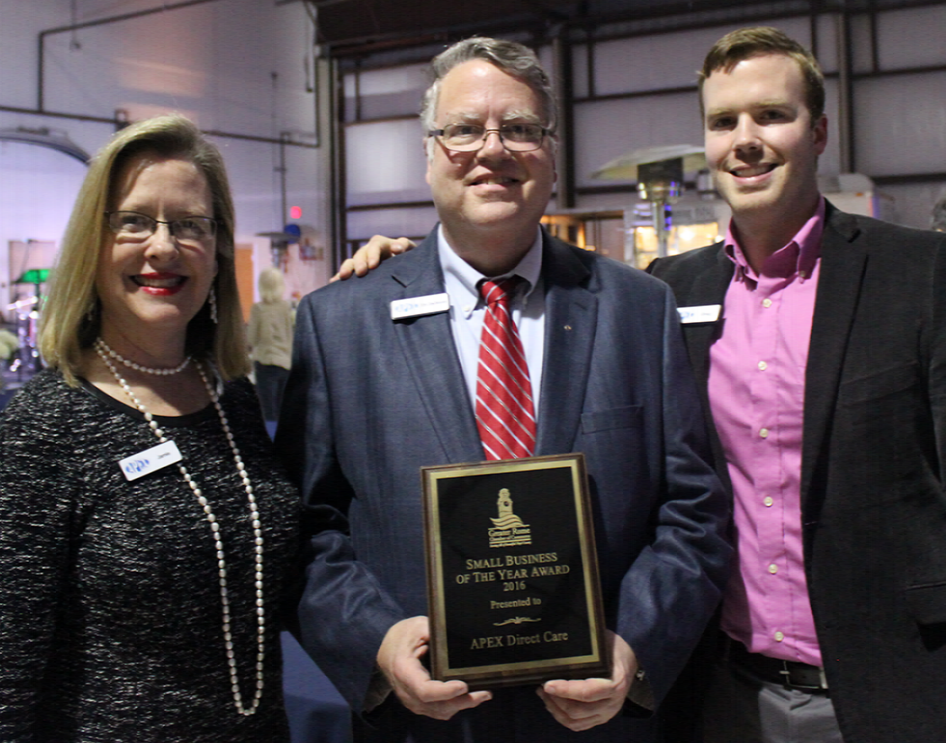 Jamie, Dr. Jackson and Greg accept the 2017 Small Business of the Year Award.