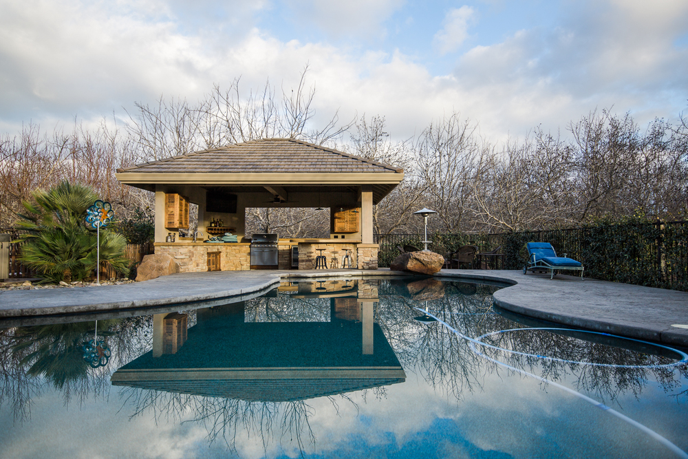 airehart-construction-durham-home-pool house-custom-beautiful-outdoor-kitchen-bar-29.jpg
