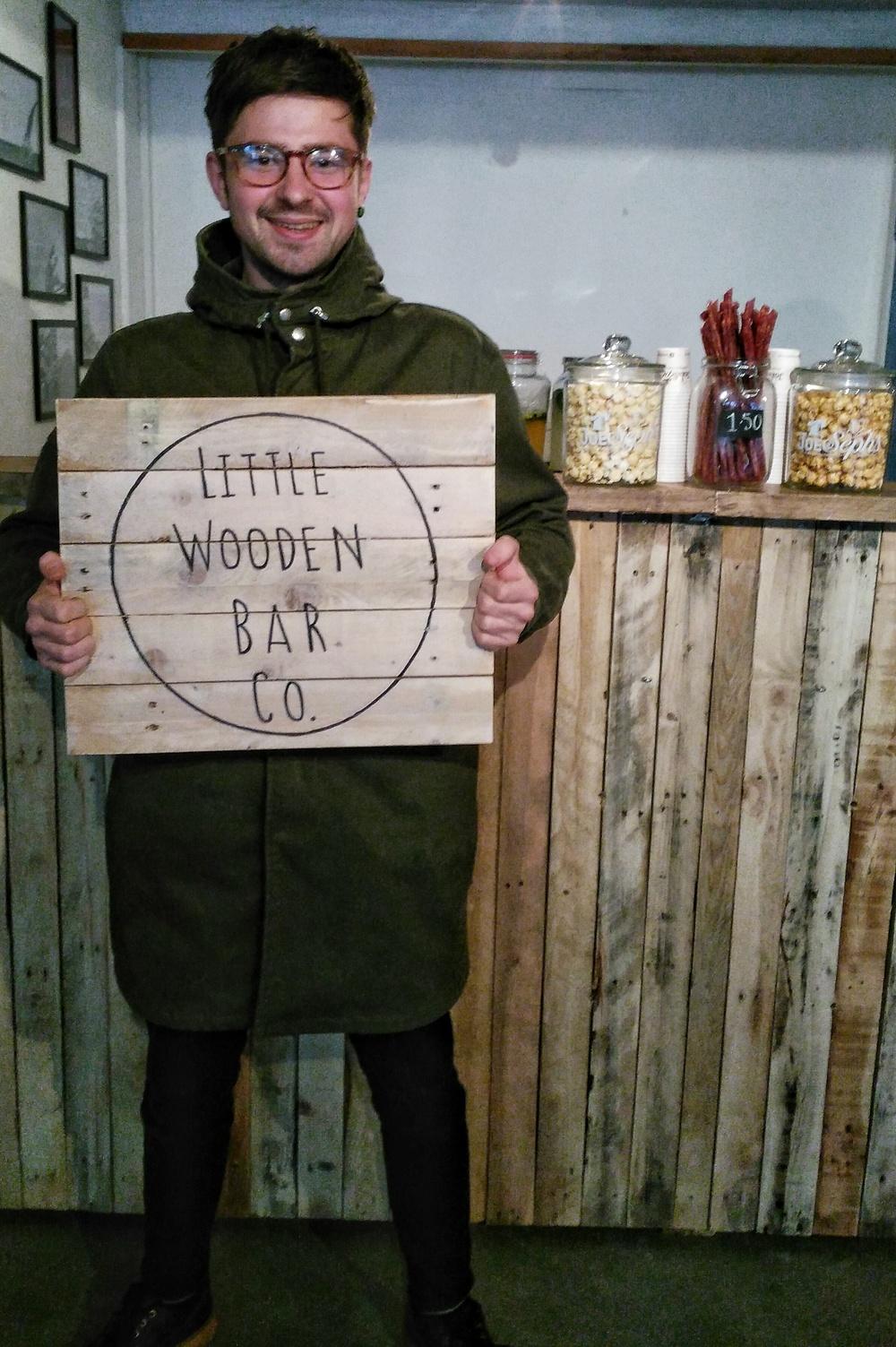 Matt posing with our bar sign...