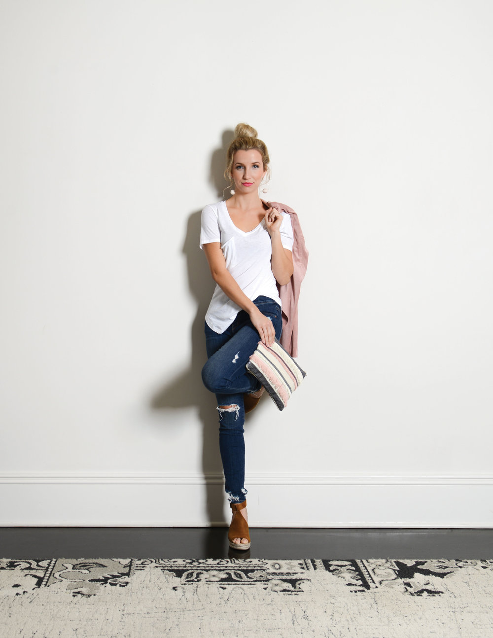 White T-shirt from Shop Swagger $30  |  Jeans from Scout & Molly's $132  |  Jacket from Sophie & Mollies Boutique $115  |  Shoes from Vestique $40 Earrings from Pink Magnolia Boutique $24  |  Clutch from Scout & Molly's $52  |  Stylist: Brittany Murdock