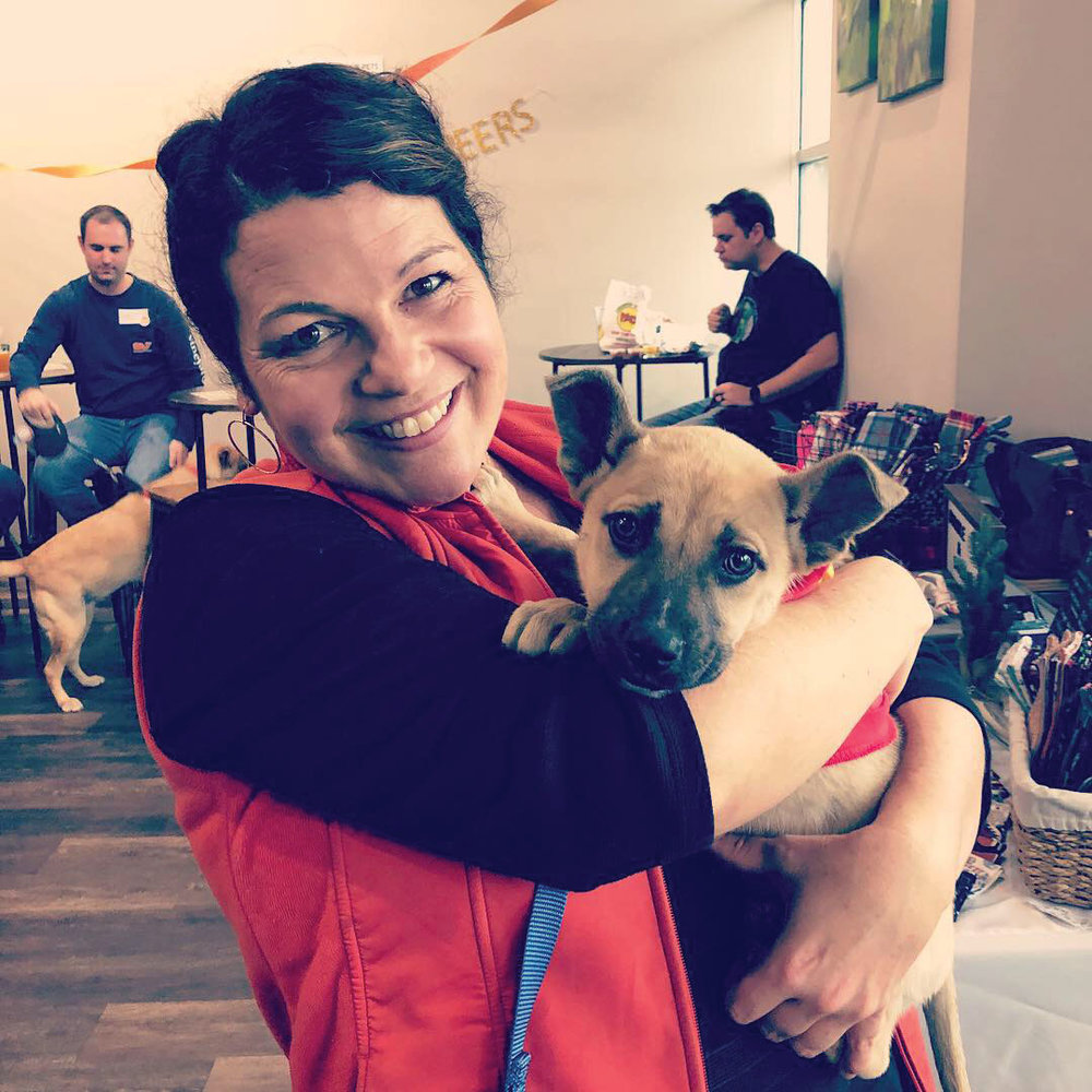 Owner Lesley White with Paw Prints adoptable puppy, Brewster (who got adopted from the event!)