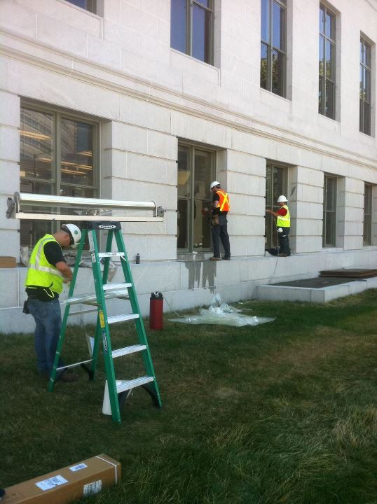 Solar Vision Inc. install team applying 3M Graffiti Film to the Denver City and County Courthouse.