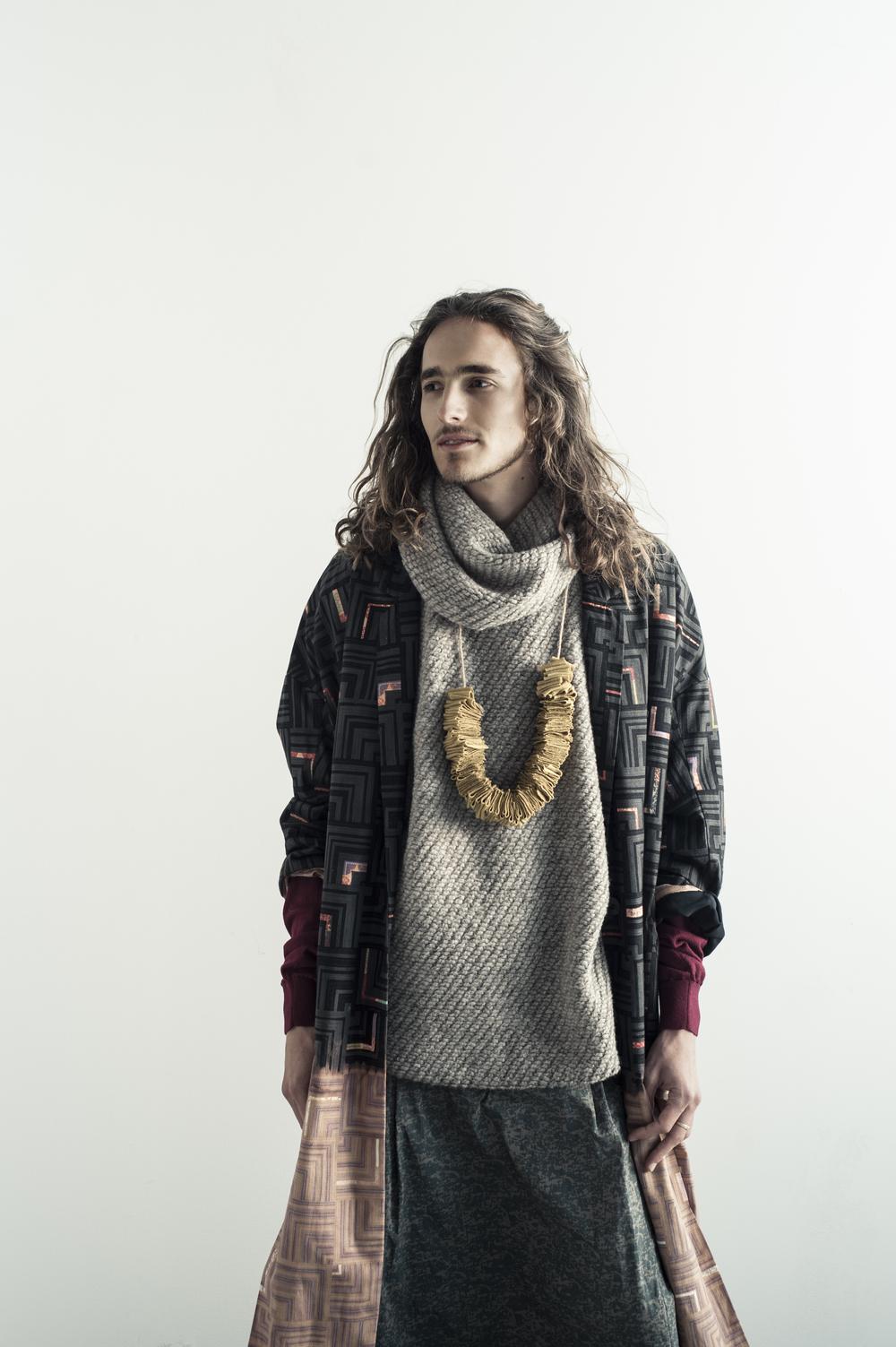 Coat by Gwen Shihyao Lai, MFA Fashion Design. Pants by Ryan Mora, BFA Fashion Design and Melissa Avalos, BFA Textile Design. Sweater by Elizabeth Castellon, MFA Fashion Design. Necklace made from UNIQLO sweater.