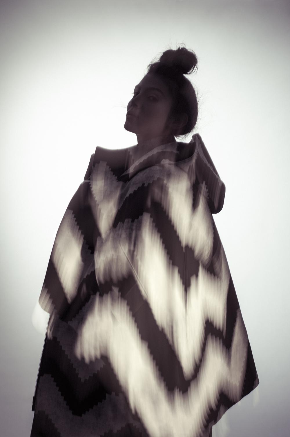 Coat and dress by Mingyu Du, MFA Fashion Design and Joseph Khawane, MFA Textile Design. Shoes, Aldo.