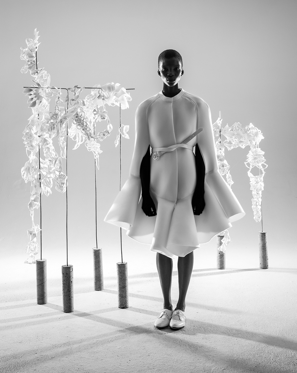Cape by Nika Tang, MFA Fashion Design. Belt and shoes stylist's own. Prosthetic models from the School of Architecture.