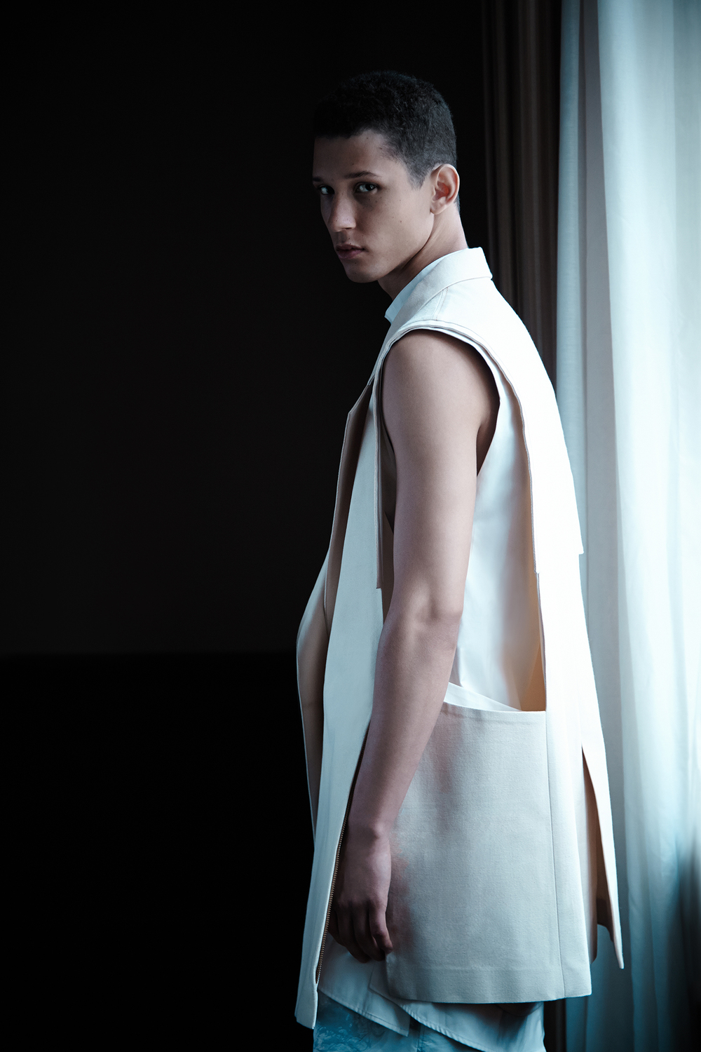 Sleeveless Jacket by Ruone Yan, BFA Menswear Design. Shirt by Dominic Tan, BFA Menswear Design. Shorts by Kevin C. Smith, MFA Menswear Design, and Andrea Nyberg, MFA Textile Design.
