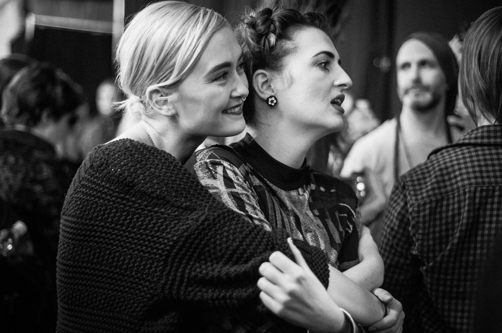 Designers Arijana Kajdic and Nisha Hanna Btesh watching the runway monitor.