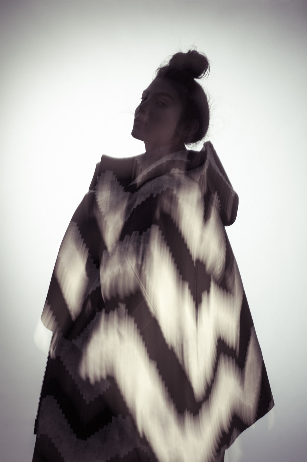 Coat and Dress by Mingyu Du, MFA Fashion Design and Joseph Khawane, MFA Textile Design.