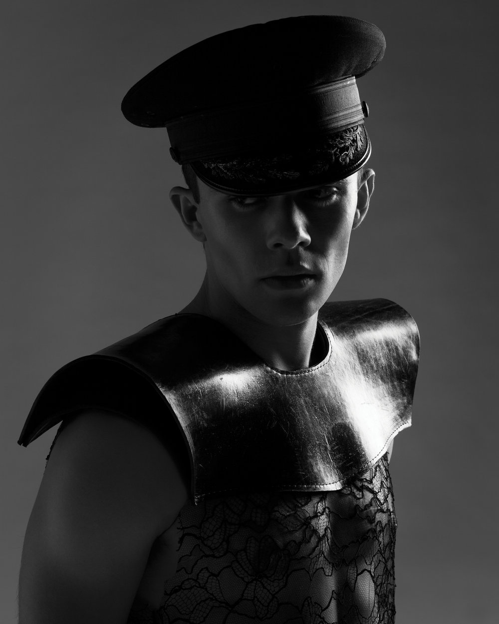Leather Shoulders by Oshrat Ben-Issac, BFA Fashion Design. Sophie Hallette lace tank, stylist's own. Hat, stylist's own.