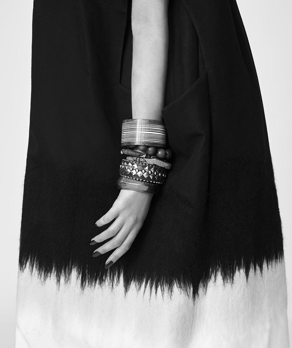 Vest by Xiuzhen Li, BFA Fashion Design. All jewelry, stylist's own.