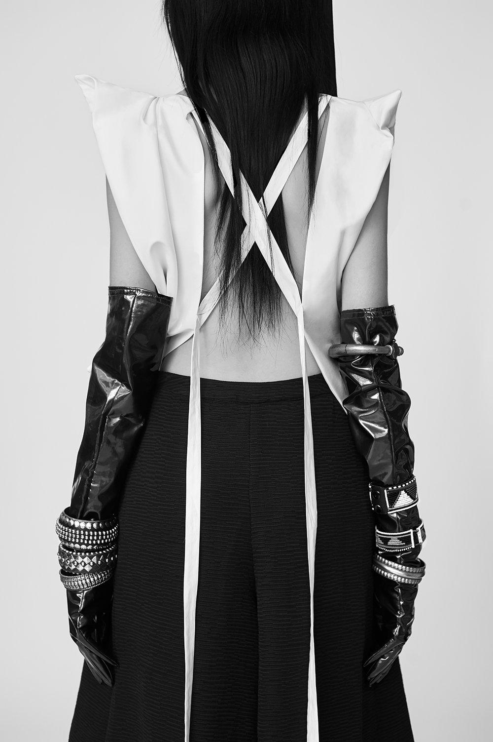 Top by Karin Kate Wong, BFA Fashion Design. Culotte by Jiaqi Lu, BFA Fashion Design. Vintage gloves. All jewelry, stylist's own.