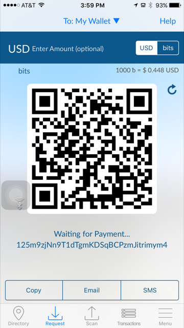 Then scan your QR Code by holding your phone in front of the scanner's red light; hold your phone near the bottom of the keypad. Depending on your wallet, bringing up your wallet's QR Code address is done by pressing Receive Bitcoin or in the case of the Blockchain app, by pressing the down right arrow.