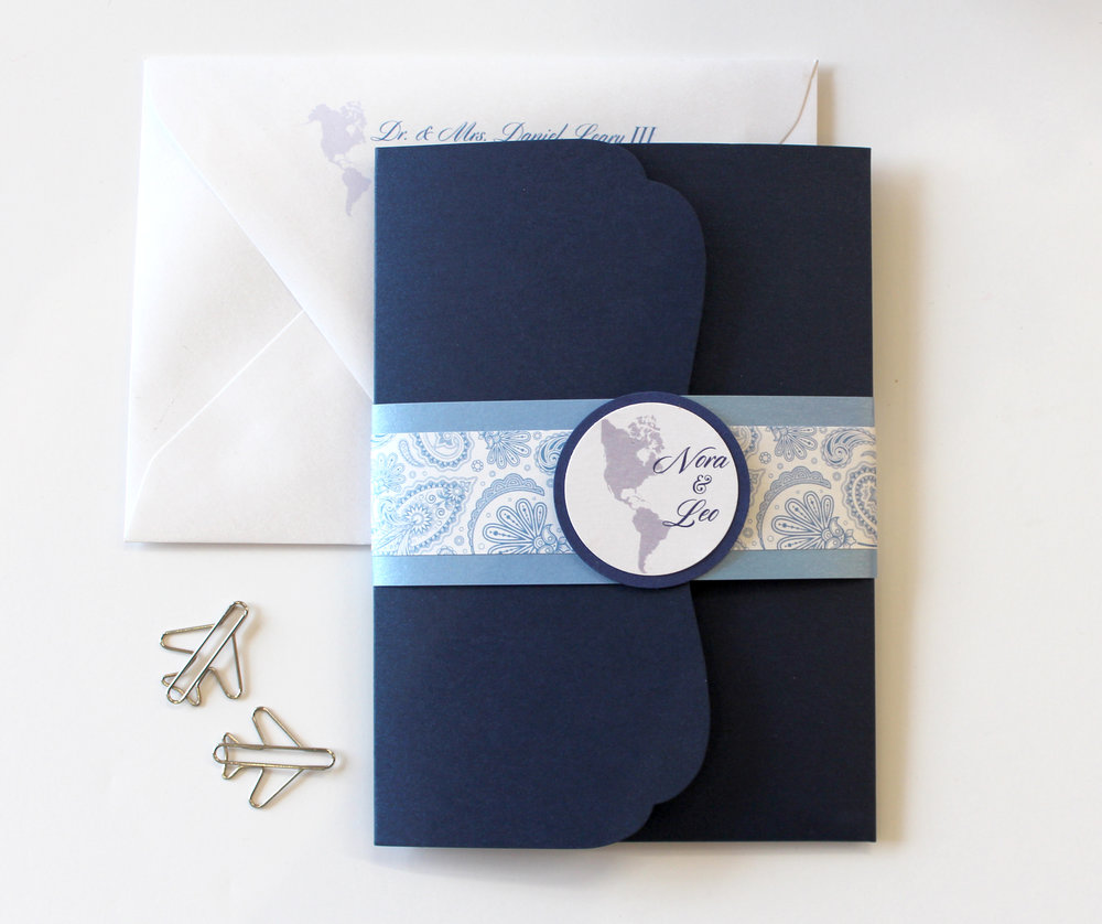 The Jetsetter   For the world travelers that just need to share their wanderlust. Pocketfolds are great for guests who need to travel with info, and with our extensive line of solid and patterned stocks to choose from, you're sure to find your perfect match. Band is available in a choice of solid or patterns, or the design can be simplified as our Standard Suite.