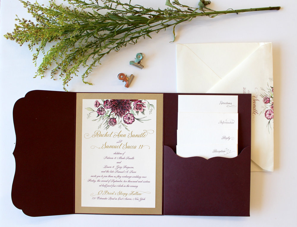 The Cascade Autumn florals tumble effortlessly from the top of this suite, setting a romantic tone.  Colors in the flowers can be adjusted for Spring or Summer, and the pocketfold is available in any color. Suite shows with digital gold printing, and four enclosure cards. For events with less information to send to your guests, this design can be simplified as our Standard Suite.