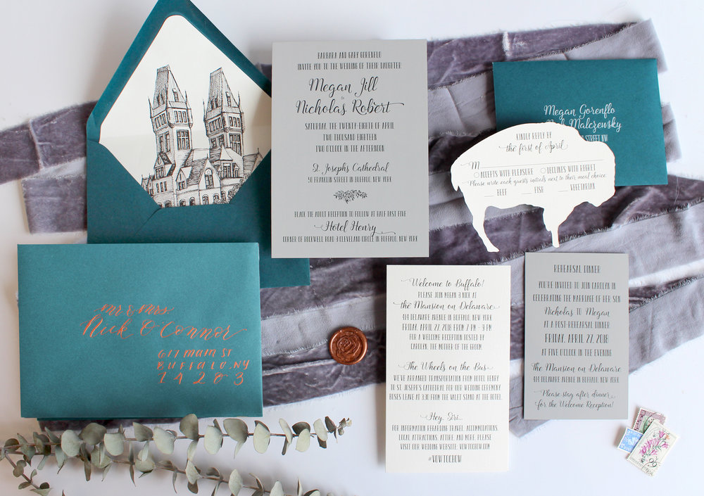 The Buffalover   This suite features a simple invitation with all the lovely extras to bring that Queen City to your wedding. Suite pictured has die cut RSVP card and venue envelope liner, but is available in any color or an upgrade to letterpress, foil and/or a pocketfold for the Couture Suite.