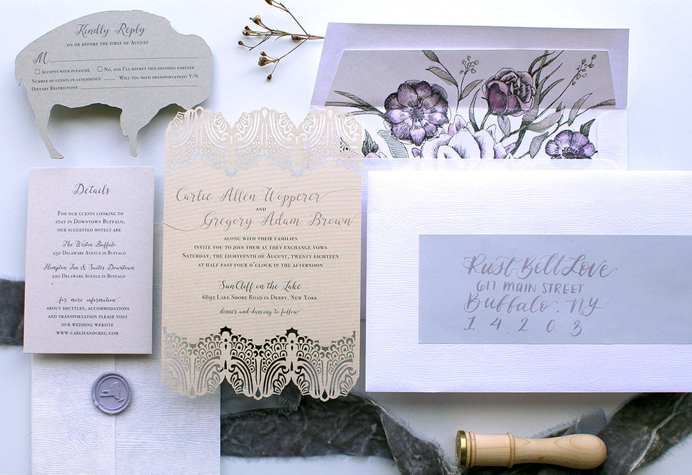The Dentelle    A laser-cut lace pattern invitation is a delicate border on this romantic suite. This suite is shown with all the bells and whistles; wax seal, die cut RSVP card, envelope liner, and address label with calligraphy, but can be customized for your colors and with whatever add-ons fit your style and budget.