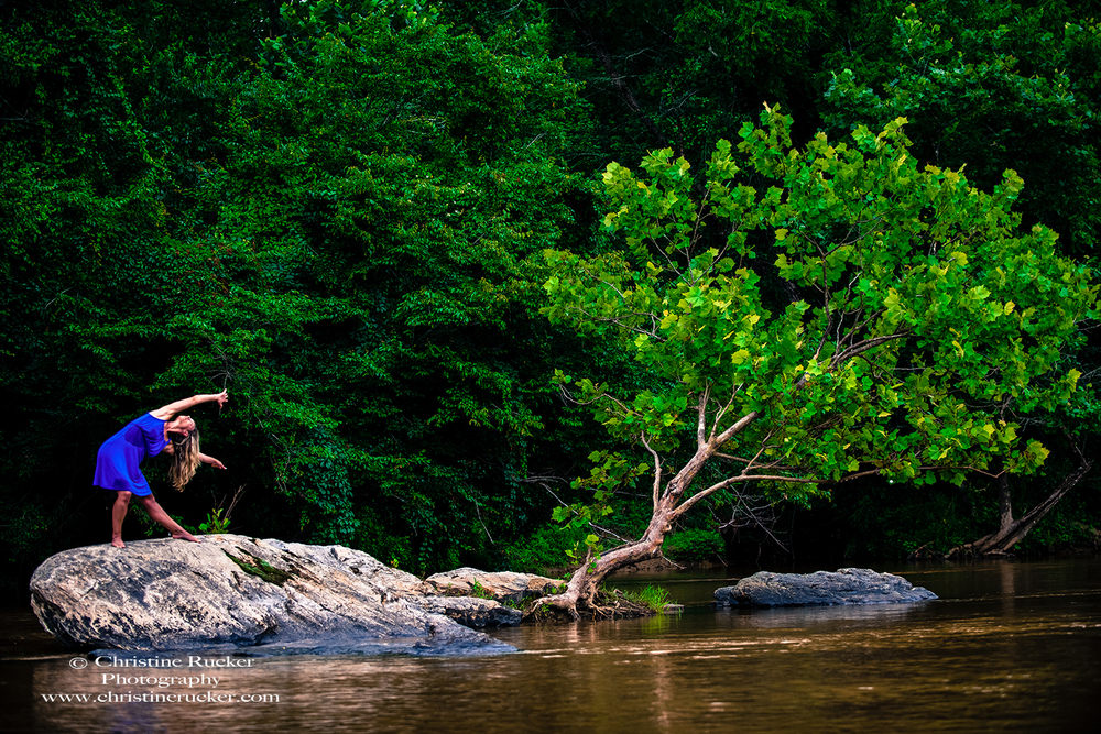 "Julianne Harper, Shoals. "" It was my first time on the Yadkin, and my first time paddling a canoe--I was able to check a few things off my ""never have I ever"" list. I enjoyed all of the locations, but I guess my favorite was the tree growing out of the rock. I liked having the goal of trying to match the tree's lines/shape, and exploring the other parts of the rock on that mini island. I was just thinking about being another tree, but there were moments when I felt like a mermaid too."""