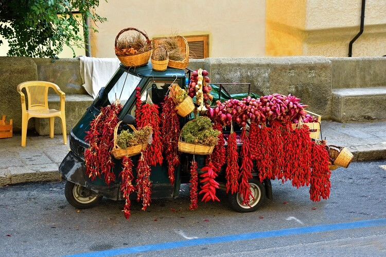 van in italy covered with the red tropea onion