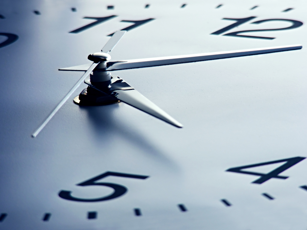 stock-photo-clock-face-with-focus-on-center-time-concept-110240975.jpg