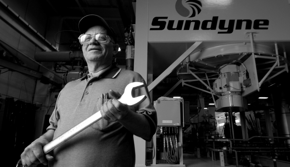 Sundyne Employee with Wrench.jpg