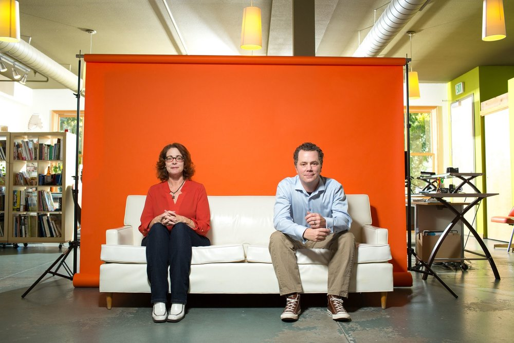 Headshot Photo of Clients in Front of Orange Backdrop Taken By the Professional Headshot Photographers at Harper Point.