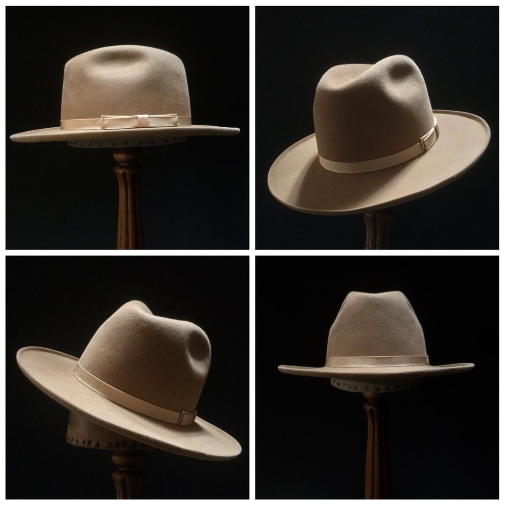 Material: 50% Wild Hare, 50% Beaver Color: Camel Brim Set: Naturalist with 45 degree Brim Curl Trim: 3/4 inch Grosgrain Ribbon with Double Double Back Bow
