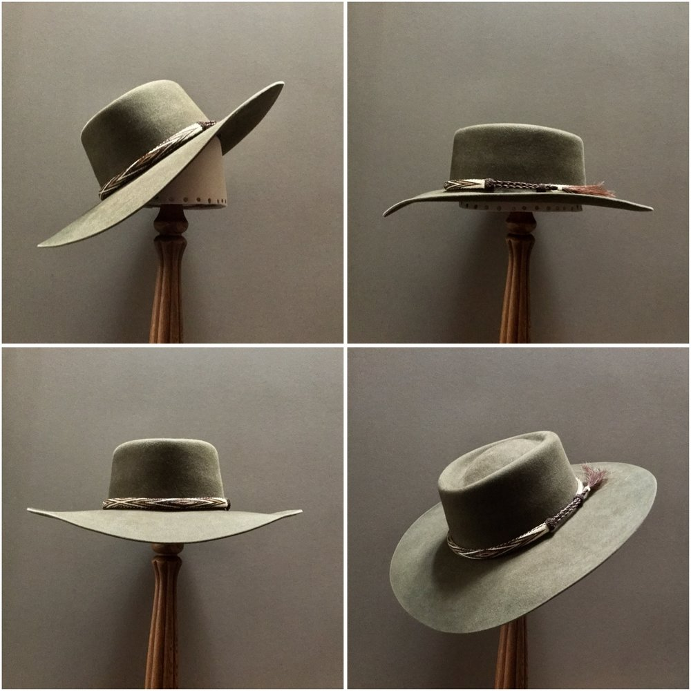 Material: 100% Beaver Color: Olive Drab Brim Set: Naturalist, Wide Drop Front, Contour Brim Trim: Hitched Horsehair