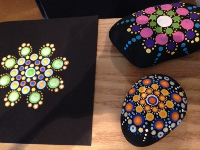Mandalas painted by students in a beginner workshop.