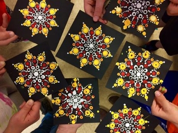 Mi'kmaq Star mandala pattern painted by grade 5 students.