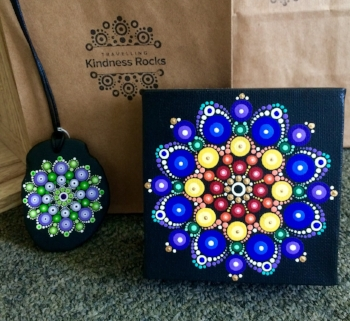 Our dot mandalas are created by the volunteer members of the Travelling Kindness Rocks Dotting Team.