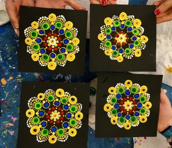 Mandalas following the Kente cloth - inspired pattern, dotted by grade 5 students.