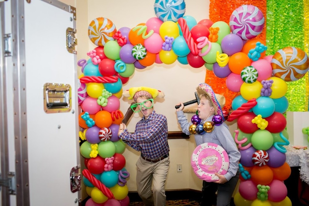 open air booth entertainment candy theme balloon decor