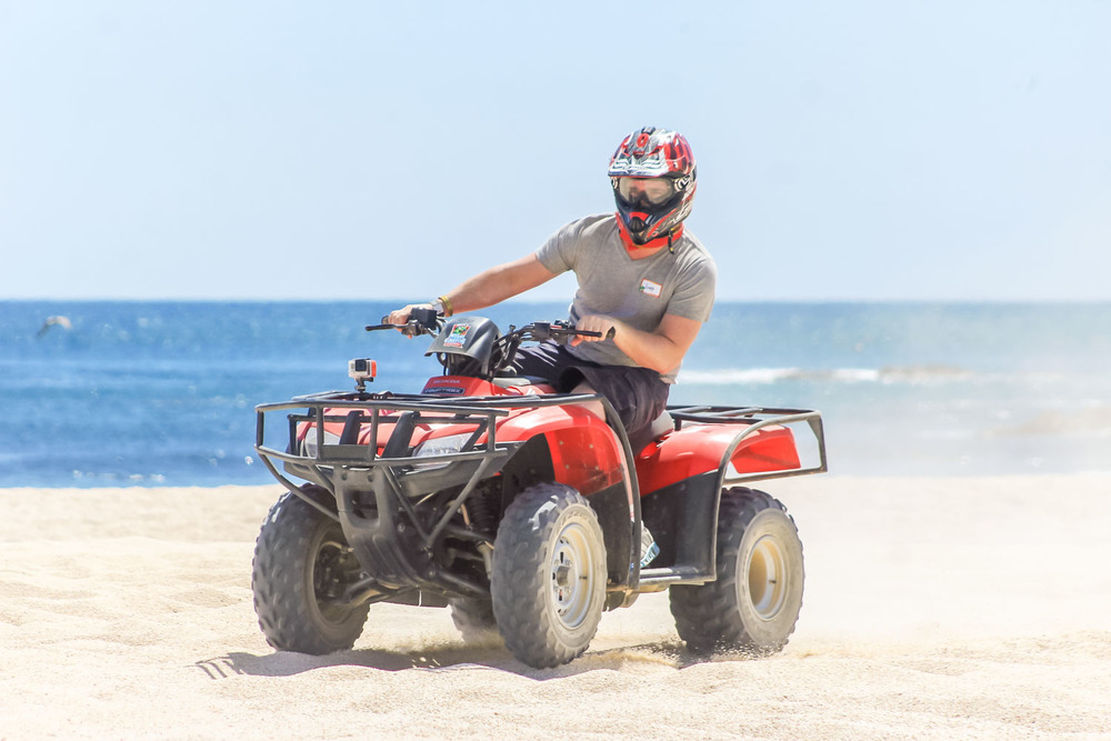 Riding ATV on the beach