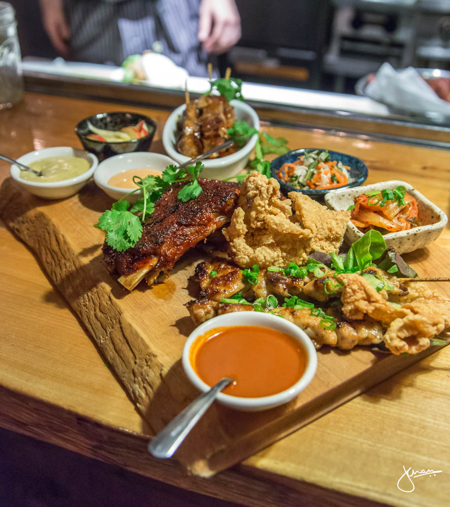 Family Style Bao Board - Maple Garlic Soy Chicken Skewers, Soy Garlic Tenderloin Skewers, Korean Spiced Pork Rib, Asian Slaw, Kimchee & Pickled Cucumber