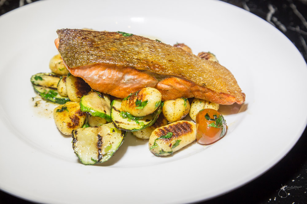 Pan Seared Salmon - fried potato gnocchi, grilled zucchini, roasted garlic aglio e olio