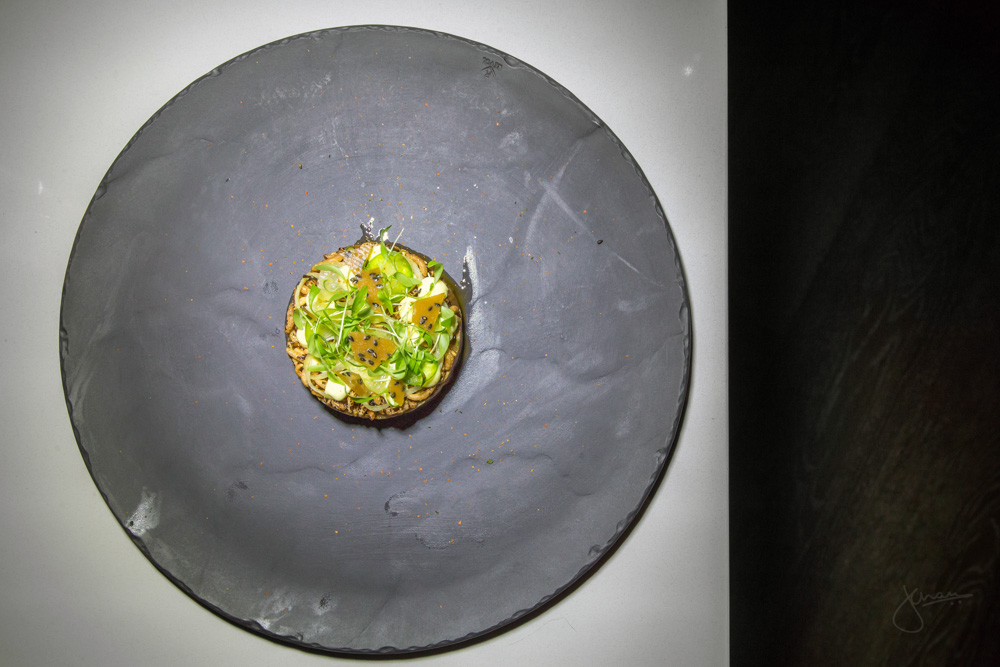 Albacore Tuna Tartare - egg yolk purée, pickled cucumber, jalapeno, candied lime, black sesame seeds