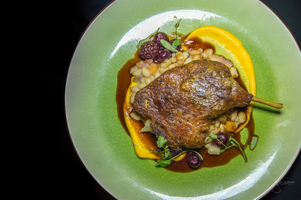 Confit Five Spiced Duck Leg - white bean, chinese sausage, dark cherry sauce