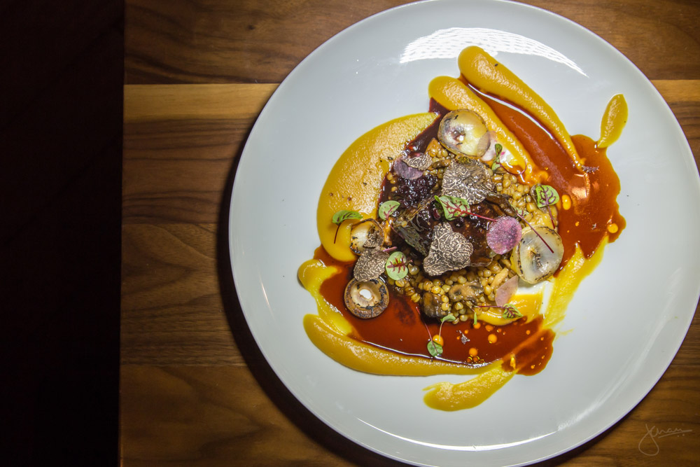 Braised Wagyu Short Rib - truffle, marrow-pumpkin puree, chanterelles, red winter wheat berries, huckleberry-black garlic-aged balsamic, cipollini