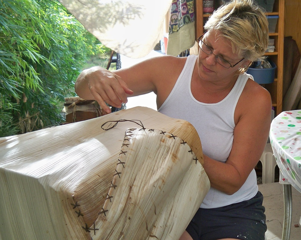 Shelley stitching a large blonde queen palm.jpg