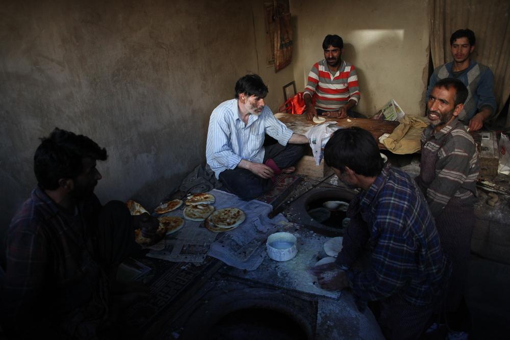 Men create Naan bread in Leh, Ladakh.