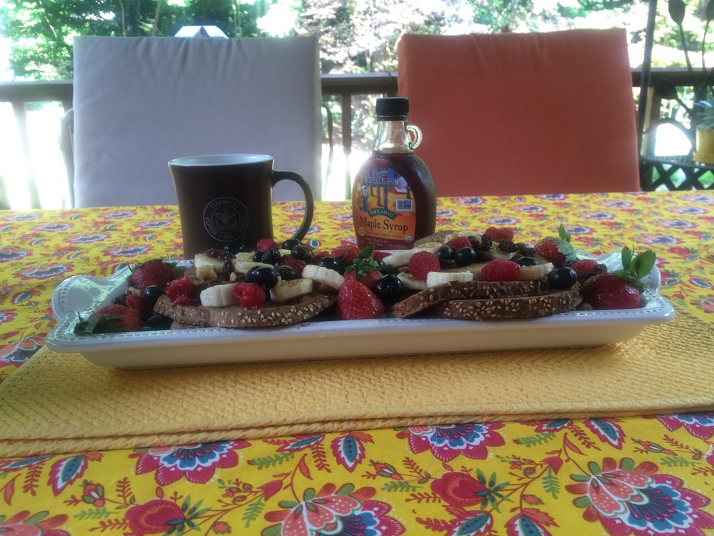"""French Toast recipe from """"The Happy Herbivore"""" with lots and lots of delicious fruit and real maple syrup. Mindful Eating couldn't be sweeter."""