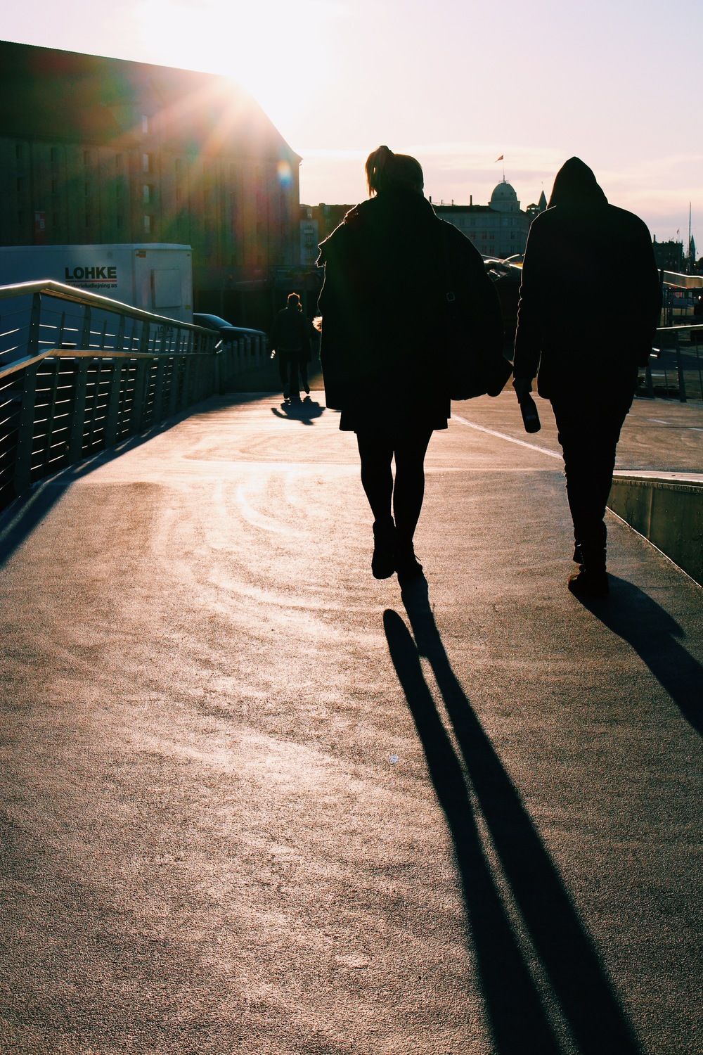 ppl walking shadow paper island.jpg