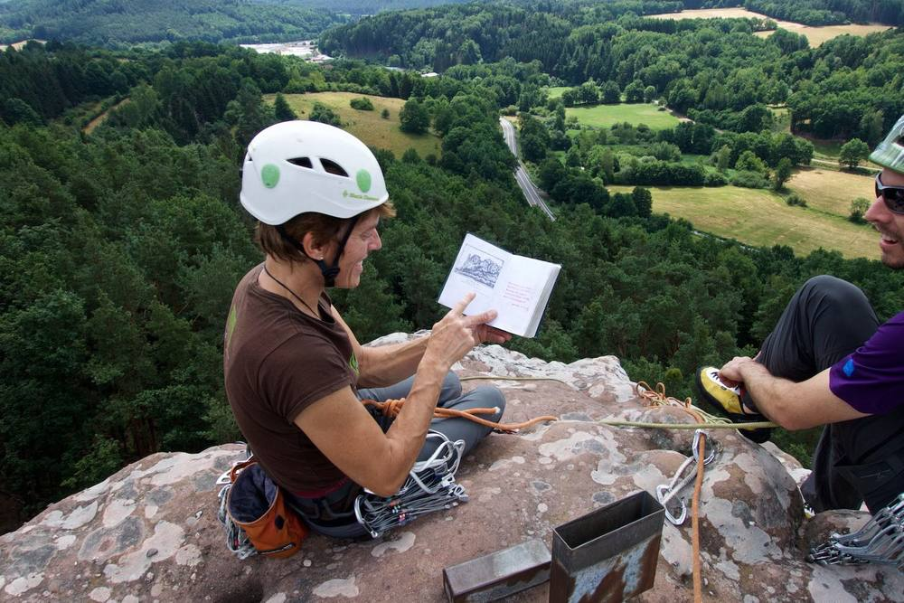 Climbing in Pfalz, signing a logbook on top of a tower