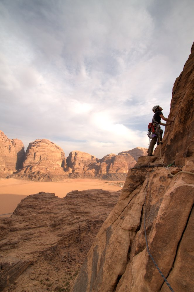 Climbing on the massive 600m high Jebel Rum