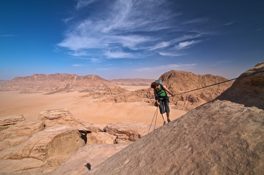 Abseiling after climbing near Burdah Arch