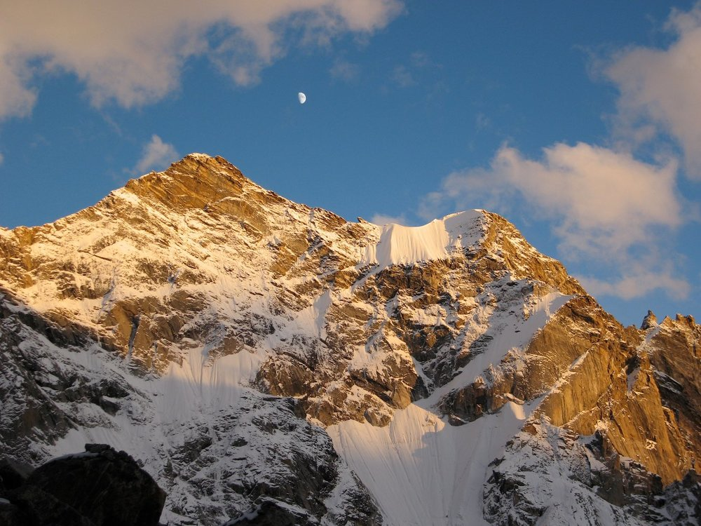 Moonrise over the snow-clad peaks across from our glacier camp