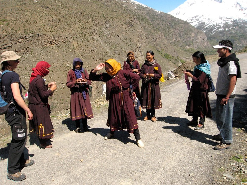 Meeting some very jovial and lively Tibetan nuns on a hike up to a monastery near Tupchiling. Note the knitting -they knit and walk!