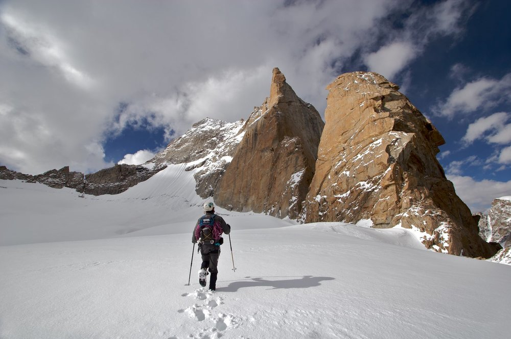 Unclimbed rock towers in a high snow basin