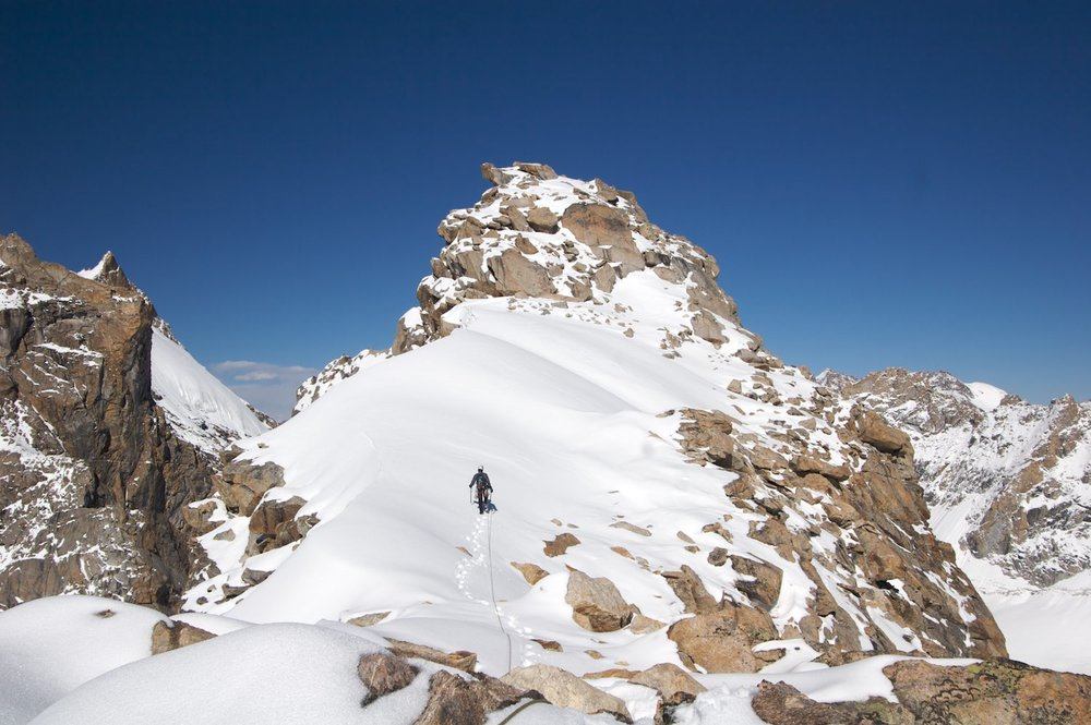 Heading to the highest of the triple summits