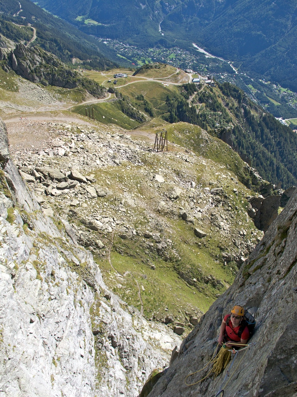 Climbing the Brévent in Chamonix. There is a paragliding launch behind